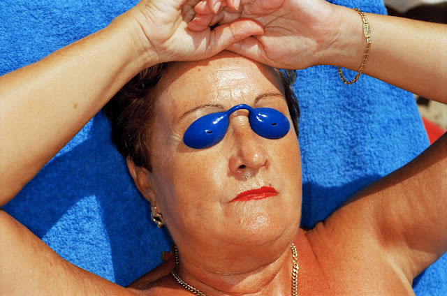 martin-parr-common-sense-woman-sunbathing-spain-1997