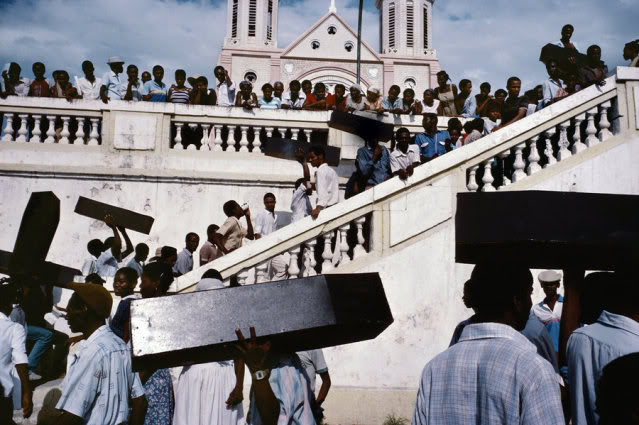 HAITI. Port-au-Prince. 1987. A memorial for victims of army violence.   Contact email: New York : photography@magnumphotos.com Paris : magnum@magnumphotos.fr London : magnum@magnumphotos.co.uk Tokyo : tokyo@magnumphotos.co.jp Contact phones: New York : +1 212 929 6000 Paris: + 33 1 53 42 50 00 London: + 44 20 7490 1771 Tokyo: + 81 3 3219 0771 Image URL: http://www.magnumphotos.com/Archive/C.aspx?VP3=ViewBox_VPage&IID=2S5RYDW16B0Q&CT=Image&IT=ZoomImage01_VForm