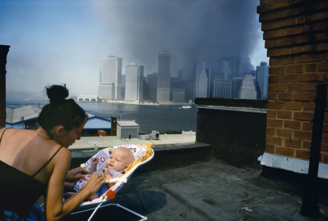 USA. New York City. September 11, 2001. View of Lower Manhattan from a Brooklyn Heights rooftop.  Contact email: New York : photography@magnumphotos.com Paris : magnum@magnumphotos.fr London : magnum@magnumphotos.co.uk Tokyo : tokyo@magnumphotos.co.jp Contact phones: New York : +1 212 929 6000 Paris: + 33 1 53 42 50 00 London: + 44 20 7490 1771 Tokyo: + 81 3 3219 0771 Image URL: http://www.magnumphotos.com/Archive/C.aspx?VP3=ViewBox_VPage&IID=2K7O3RK9K9K&CT=Image&IT=ZoomImage01_VForm