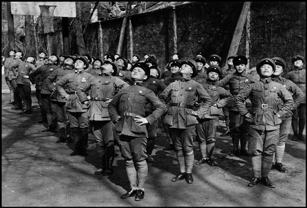 CHINA. Hubei. Hankou.  March, 1938. Young women being trained as Nationalist Chinese soldiers. After having lost Shanghai and Nankijng to the Japanese troops, CHANG KAI SHEK retreated to Hankou, where he resisted until late 1938. Contact email: New York : photography@magnumphotos.com Paris : magnum@magnumphotos.fr London : magnum@magnumphotos.co.uk Tokyo : tokyo@magnumphotos.co.jp Contact phones: New York : +1 212 929 6000 Paris: + 33 1 53 42 50 00 London: + 44 20 7490 1771 Tokyo: + 81 3 3219 0771 Image URL: http://www.magnumphotos.com/Archive/C.aspx?VP=Mod_ViewBoxInsertion.ViewBoxInsertion_VPage&R=2S5RYDW0PZIM&RP=Mod_ViewBox.ViewBoxZoom_VPage&CT=Image&SP=Image&IT=ImageZoom01&DTTM=Image&SAKL=T